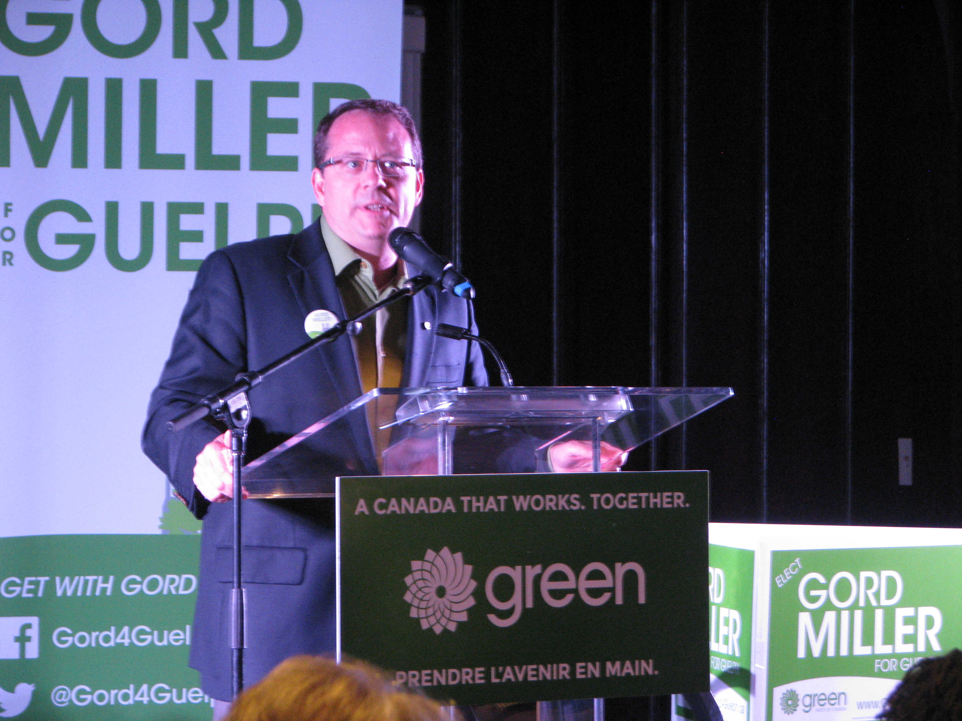 Mike Schreiner speaking at Gord Miller's GPC Town Hall in Guelph