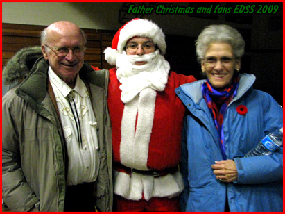 Grandpa and Nanny pose with Father Christmas