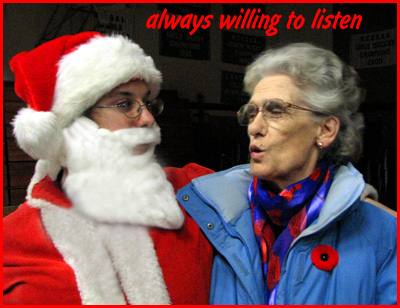 Father Christmas (Willem) listens to a little girl's Christmas wish (Nanny)